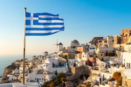 Greek Flag, Oia, Santorini, Greece - Chris Hepburn/The Image Bank/Getty Images
