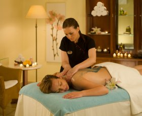 Mykonos Grand Spa relaxing treatment with therapist reinvigorating guest during Mykonos treatment